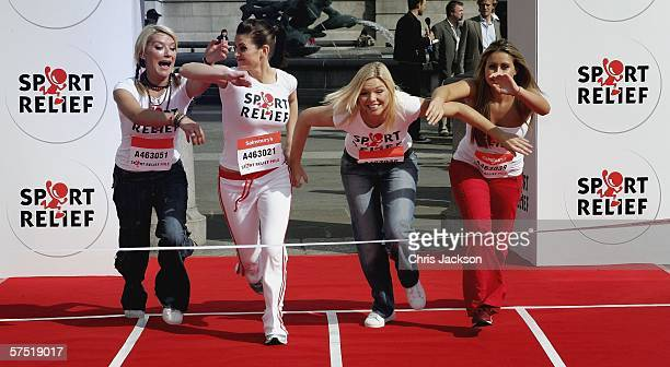 Zoe Lucker Kirsty Gallacher Kate Thornton and Sarah Barrand run for the finish line in Trafalgar Square to launch Sport Relief on May 3 2006 in...