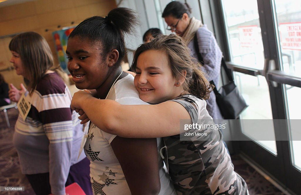 Zoe McCoy (R), 9, hugs Hannah Adams, 12, during the Shapedown program for overweight adolescents and children on November 20, 2010 in Aurora, Colorado. The 10-week family-centered program held by the Denver area Children's Hospital teaches youth and their parents ways to lead a healthier more active lifestyle, as a longer lasting weight-loss alternative to dieting. Nationally, some 15 percent of children are overweight or obese, as are some 60 percent of adults.