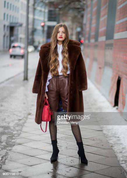 Zoe Pastelle wearing top Anne Fontaine brown shors Boss red Celine bag brown Mango teddy coat black ankle boots sheer tights is seen during the...