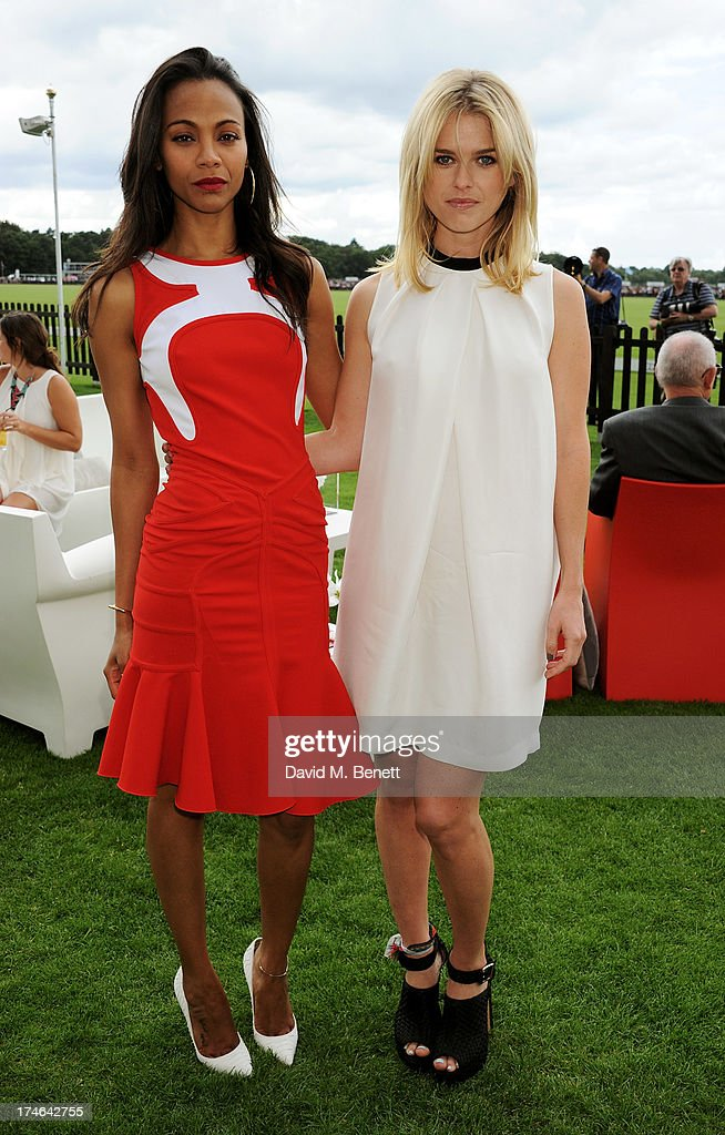 Zoe Saldana (L) and Alice Eve attend the Audi International Polo at Guards Polo Club on July 28, 2013 in Egham, England.