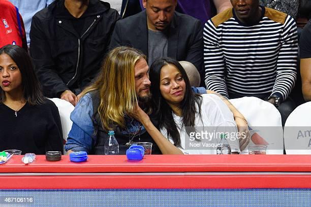 Zoe Saldana And Her Husband Marco Perego Attend A Basketball