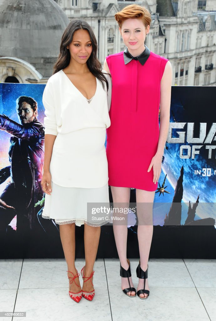 Zoe Saldana and Karen Gillan attends the 'Guardians of the Galaxy' photocall on July 25, 2014 in London, England.
