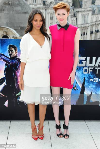 """Zoe Saldana and Karen Gillan attends the """"Guardians of the Galaxy"""" photocall on July 25, 2014 in London, England."""
