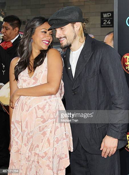 Zoe Saldana and Marco Perego arrive at the Los Angeles premiere of Book Of Life held at Regal Cinemas LA Live on October 12 2014 in Los Angeles...
