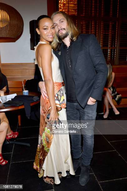Zoe Saldana and Marco Perego attend the Tamara Mellon Palisades Village Opening Party at Blue Ribbon Sushi on December 11, 2018 in Pacific Palisades,...