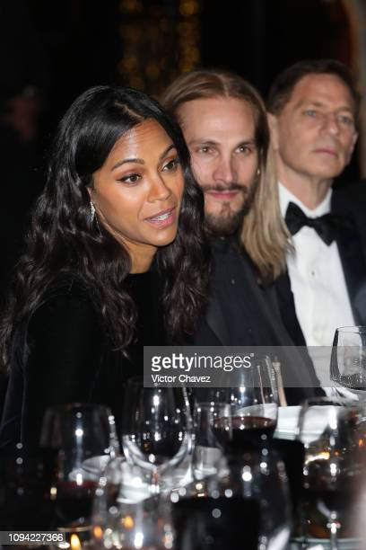Zoe Saldana and Marco Perego during the amfAR gala dinner at the house of collector and museum patron Eugenio López on February 5 2019 in Mexico City...
