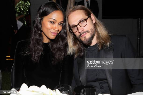 Zoe Saldana and Marco Perego pose during the amfAR gala dinner at the house of collector and museum patron Eugenio López on February 5 2019 in Mexico...