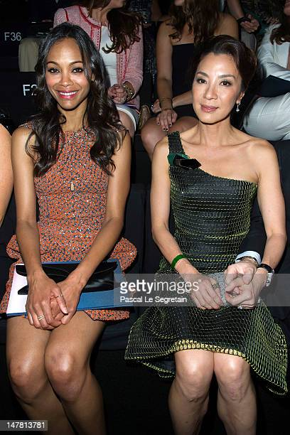 Zoe Saldana and Michelle Yeoh attend the Giorgio Armani Prive Haute-Couture show as part of Paris Fashion Week Fall / Winter 2012/13 at Palais de...