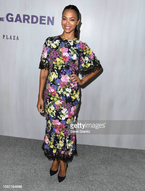 Zoe Saldana arrives at the 2018 Hammer Museum Gala In The Garden on October 14 2018 in Los Angeles California