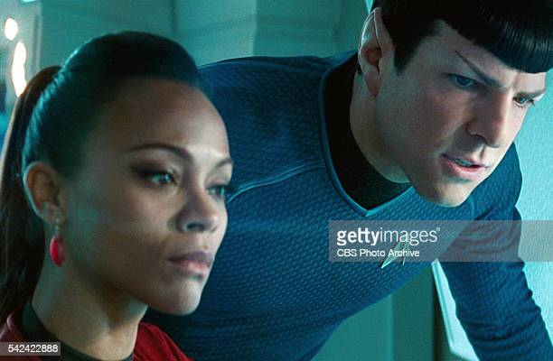 Zoe Saldana as Lieutenant Nyota Uhura and Zachary Quinto as Commander Spock on the bridge of the Starship Enterprise in the 2013 movie Star Trek Into...