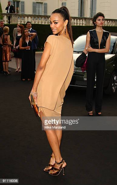 Zoe Saldana attends amfAR's Cinema Against AIDS 2009 benefit at the Hotel du Cap during the 62nd Annual Cannes Film Festival on May 21, 2009 in...