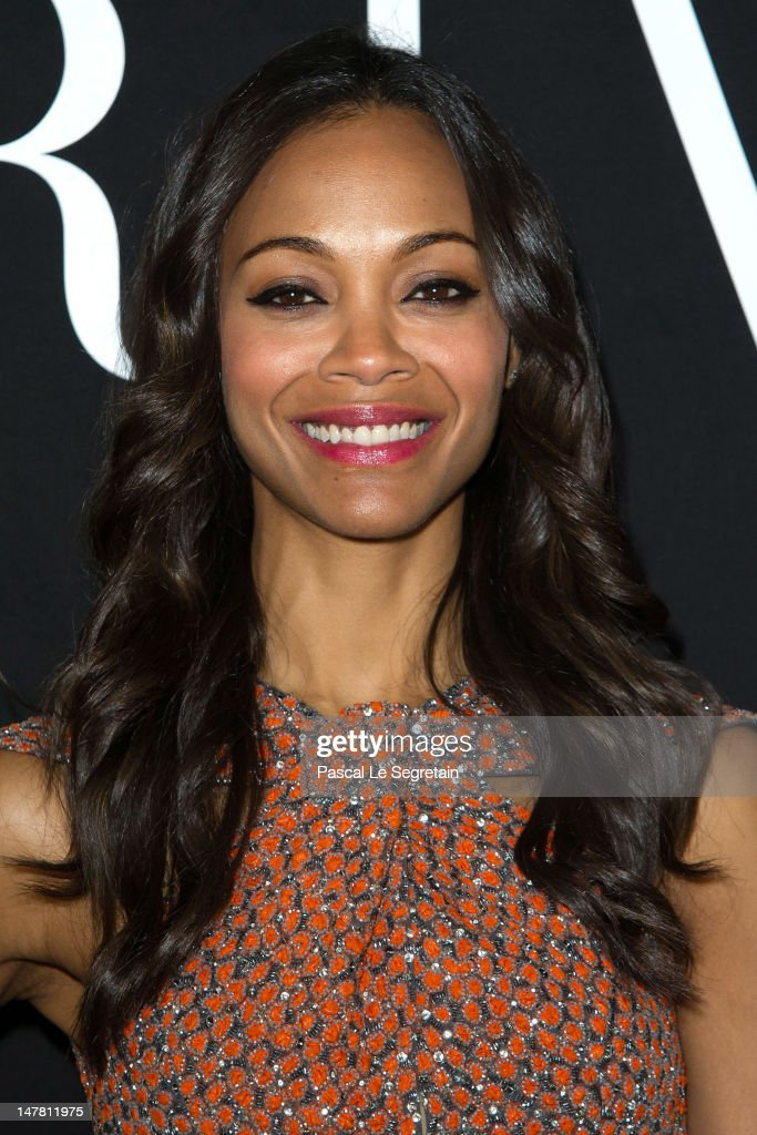 Zoe Saldana attends the Giorgio Armani Prive Haute-Couture show as part of Paris Fashion Week Fall / Winter 2012/13 at Palais de Chaillot on July 3, 2012 in Paris, France.