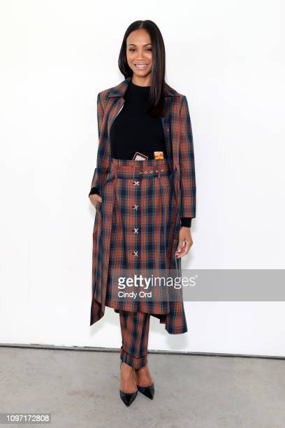 Zoe Saldana attends the Tory Burch Fall Winter 2019 Fashion Show at Pier 17 on February 10, 2019 in New York City.