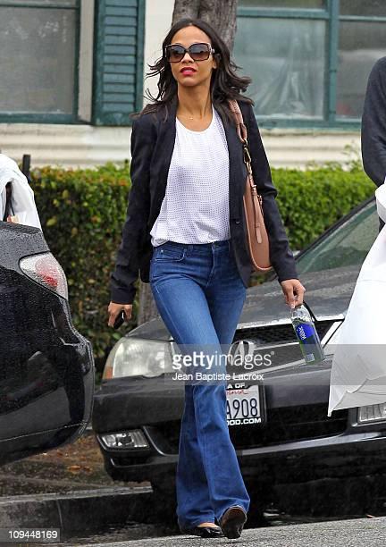 Zoe Saldana picks up dresses at Diane von Furstenberg in Beverly Hills on February 25 2011 in Los Angeles California