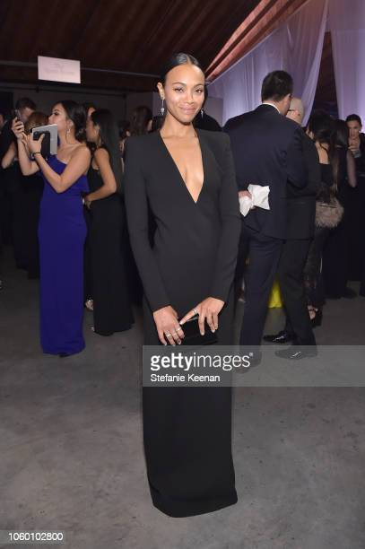 Zoe Saldana poses at the 2018 Baby2Baby Gala Presented by Paul Mitchell at 3LABS on November 10 2018 in Culver City California