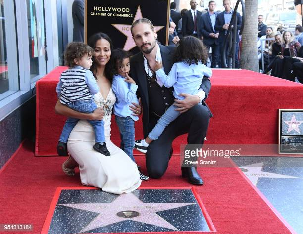 Zoe Saldana with Marco Perego and their children Bowie Cy and Zen attend Zoe Saldana's star on the Hollywood Walk of Fame celebration ceremony on May...