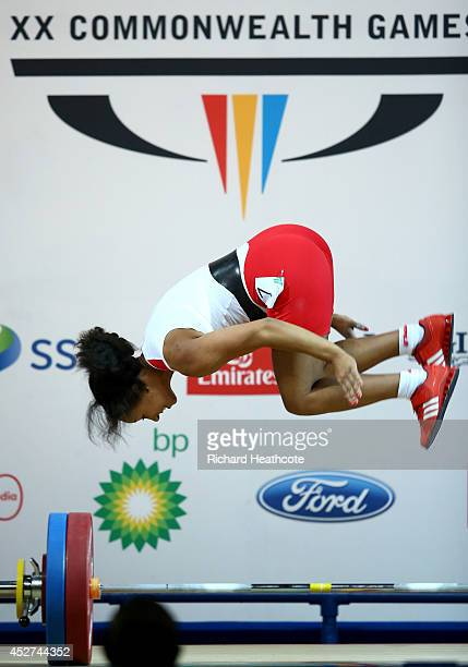 Zoe Smith of England celebrates as she lifts a new Commonwealth Record to win Gold in the Women's 58kg A Final at Scottish Exhibition And Conference...
