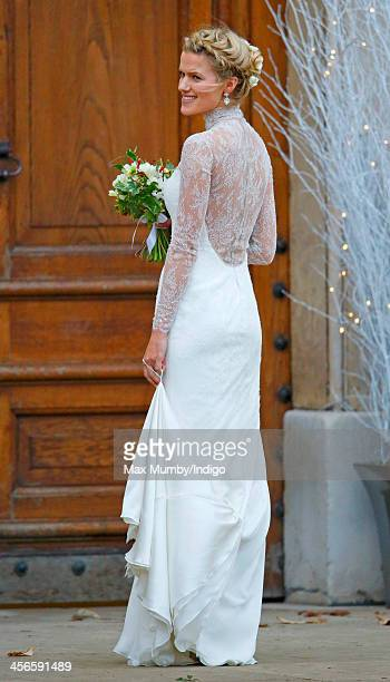 Zoe Stewart arrives at the Wren Chapel in the Royal Hospital Chelsea for her wedding to Jake Warren on December 14 2013 in London England
