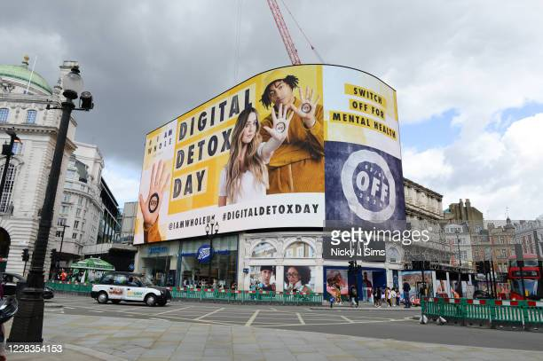 """Zoe Sugg and Jordan Stephens on the Piccadilly screen at Piccadilly Circus for """"Digital Detox Day"""" at on September 5, 2020 in London, England...."""
