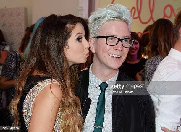 Zoe Sugg and Tyler Oakley attend YouTube phenomenon Zoe Sugg's launch of her debut beauty collection at 41 Portland Place on September 25 2014 in...