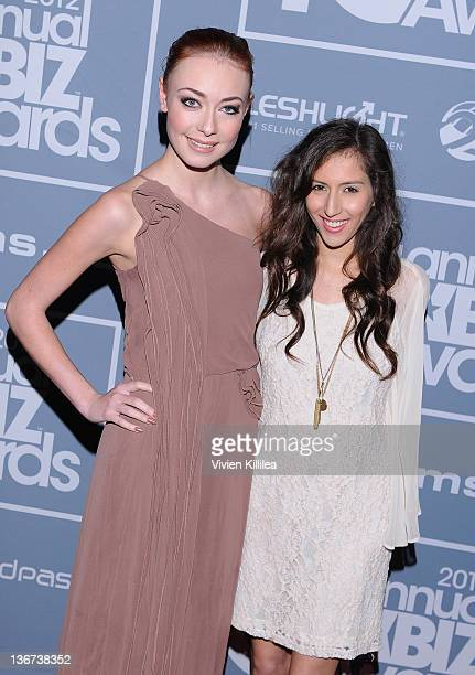 Zoe Voss and April O'Neil attend the 10th Annual XBIZ Awards at The Barker Hanger on January 10 2012 in Santa Monica California