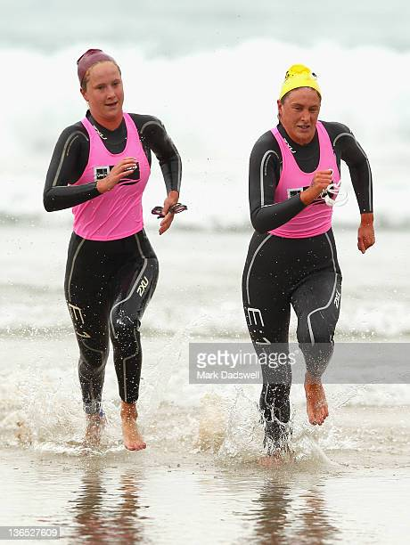 Zoe Whitfield and Laura Stekelenburg race out of the water in the Womens Open section of the 2012 Pier to Pub on January 7 2012 in Lorne Australia