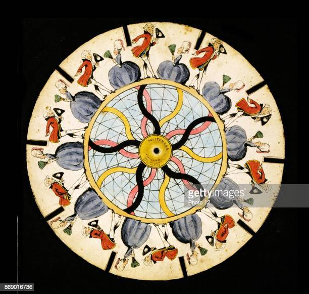 Zoetrope optical illusion disc which is spun displaying the illusion of motion of a man bowing and a woman curtsying to each other in the circle at...