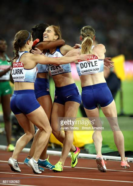 Zoey Clark Laviai Nielsen Emily Diamond and Eilidh Doyle of Great Britain celebrate winning silver in the Women's 4x400 Metres Relay final during day...