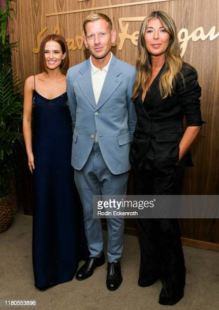 Zoey Deutch Paul Andrew and Nina Garcia attend ELLE x Ferragamo Hollywood Rising Party at Sunset Tower on October 11 2019 in Los Angeles California