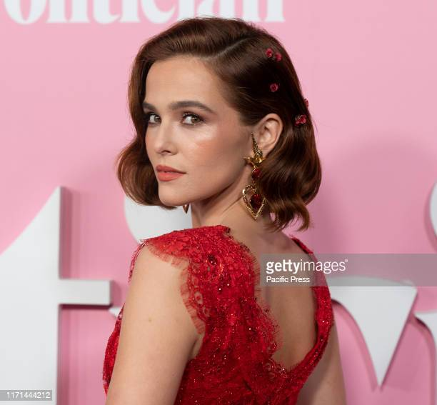 Zoey Deutch wearing dress by Rodarte attends Netflix The Politician premiere at DGA Theater.