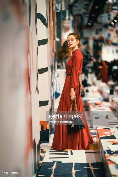 Zoey Deutch wears a red dress after Dior during Paris Fashion Week Womenswear Fall/Winter 2018/2019 on February 27 2018 in Paris France