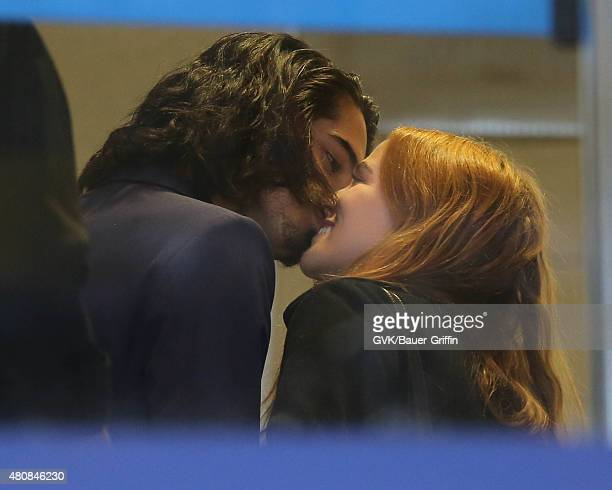 Zoey Dutch and Avan Jogia are seen at LAX on July 15 2015 in Los Angeles California