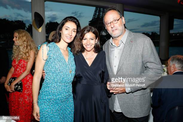 Zofia Reno Anne Hidalgo and Jean Reno attend Line Renaud's 90th Anniversary on July 2 2018 in Paris France