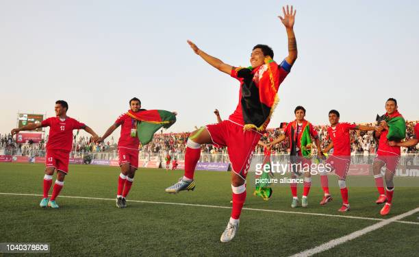 Zohib Islam Amiri of Afghanistan dances with his team mates after the end of the international soccer match between Afghanistan and Pakistan in Kabul...