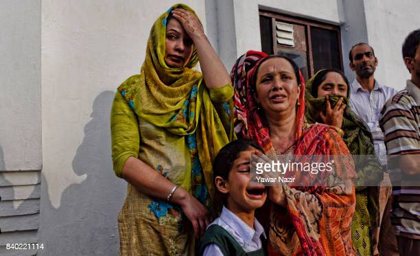 Zohra daughter of Indian police officer killed by suspected militants is being consoled during his wreath laying ceremony on August 28 2017 in...