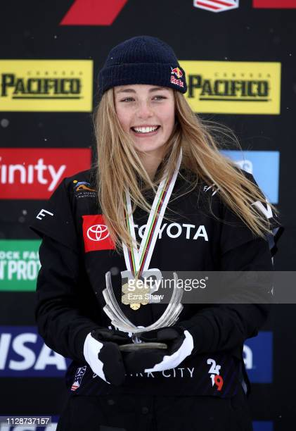 Zoi Sadowski Synnott of New Zealand stands on the podium after winning the gold medal in the Ladies' Snowboard Slopestyle Finals of the FIS Snowboard...