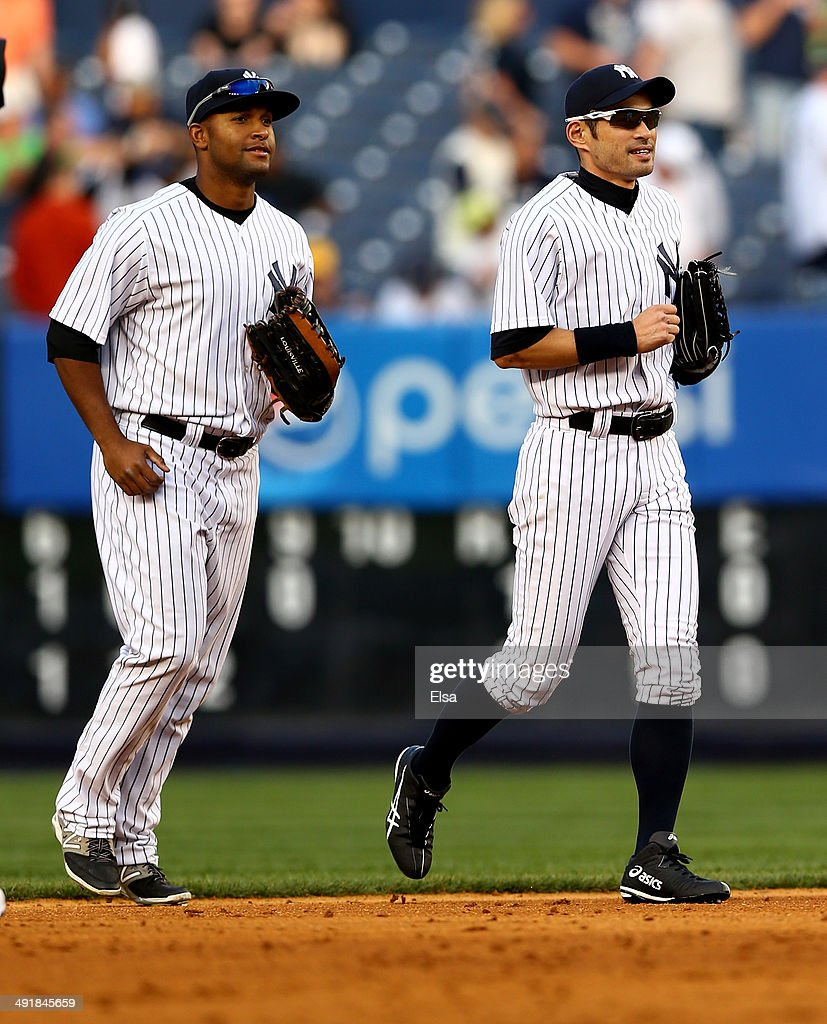 Zoilo Almonte #24 and Ichiro Suzuki #31 of the New York Yankees celebrate the win over the Pittsburgh Pirates on May 17, 2014 at Yankee Stadium in the Bronx borough of New York City.The New York Yankees defeated the Pittsburgh Pirates 7-1.