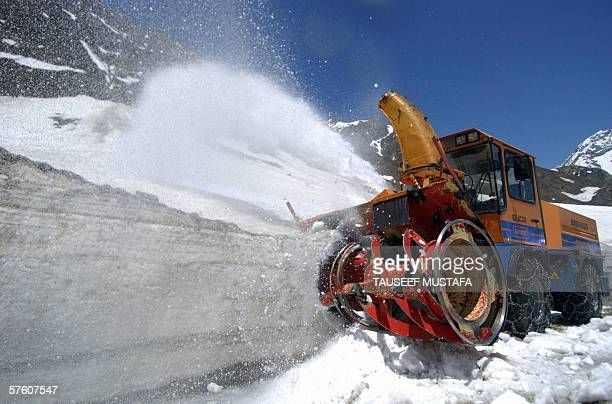 A snow cutting machine clears the Zogila pass on the SrinagarLeh National Highway after the road was opened after months of being closed for the...