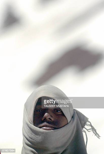 An Indian worker covers his head for warmth while working on the Zojila pass on the SrinagarLeh National Highway after the road was opened after...