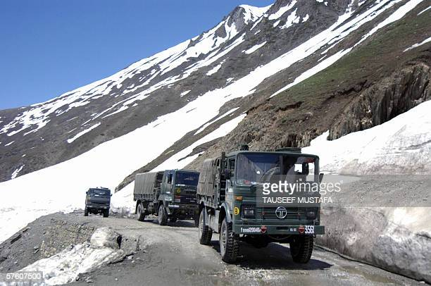 The first Indian army convoy negotiates the Zogila pass on the SrinagarLeh National Highway after the road was opened after months of being closed...