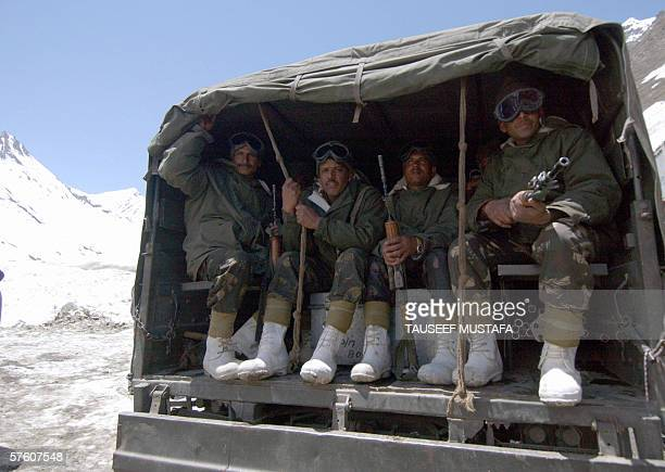 The first Indian army convoy negotiates the Zojila pass on the SrinagarLeh National Highway after the road was opened after months of being closed...