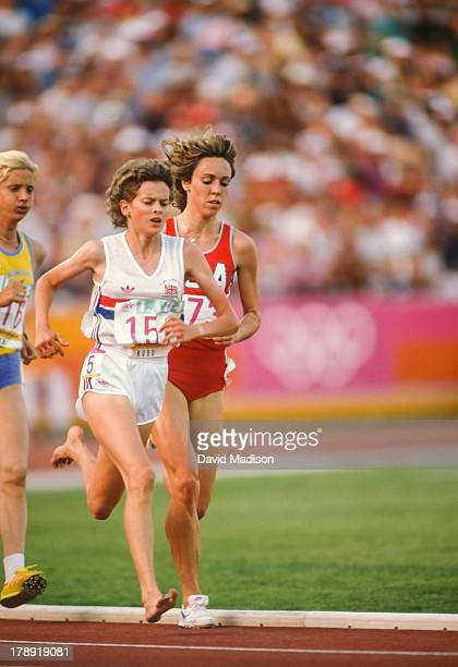 Zola Budd and Mary Decker run the Women's 3000 meter final of the 1984 Olympics held in the Los Angeles Memorial Coliseum in Los Angeles California...