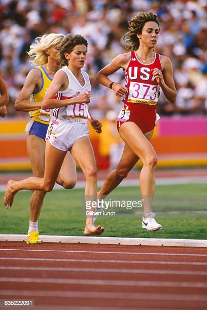 Zola Budd of Great Britain and Mary Decker of the United States run the first lap of the Womens 3000meter final in the Coliseum Behind Decker is gold...