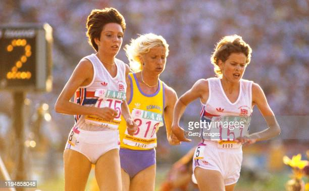 Zola Budd running bare footed and Wendy Sly of Great Britain lead from Maricica Puica of Romania with two laps to go during in the final of the...
