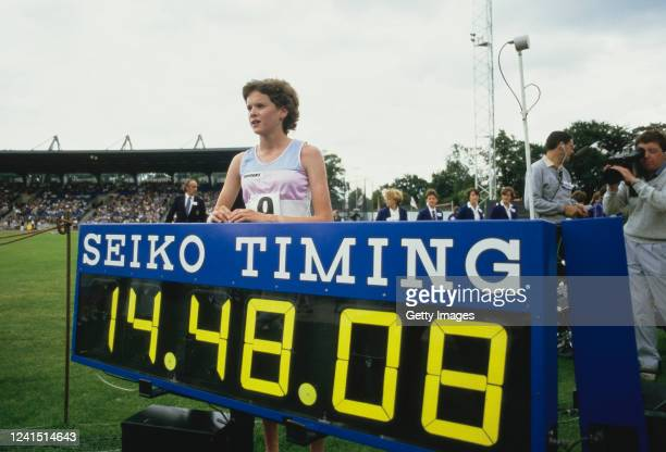 Zola Budd stands next to the Seiko Timing clock after beating the Women's 5000 metre World Record at Crystal Palace on August 26, 1985 in London,...