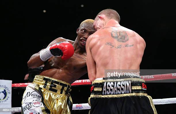 Zolani Tete of South Africa hits Paul Butler of England with a left shot that floors Butler and who is subsequently counted out by the referee during...