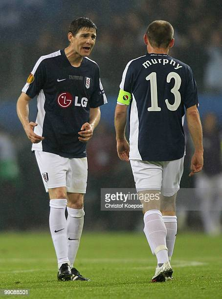Zoltan Gera and Danny Murphy of Fulham react during the UEFA Europa League final match between Atletico Madrid and Fulham at HSH Nordbank Arena on...