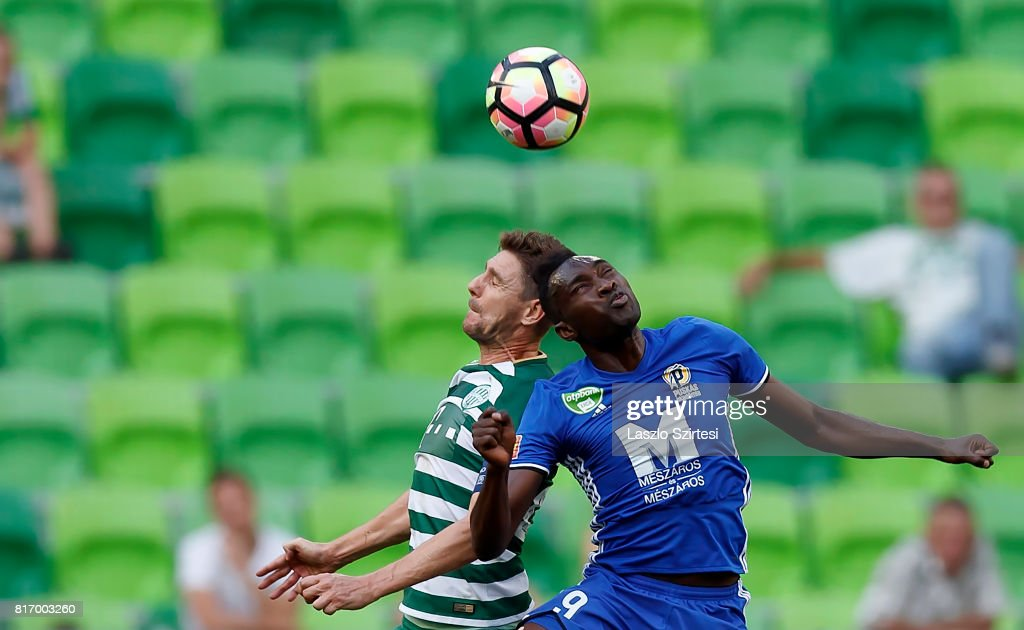 Zoltan Gera (L) of Ferencvarosi TC competes for the ball in the air with Ulysse Diallo #9 of Puskas Akademia FC during the Hungarian OTP Bank Liga match between Ferencvarosi TC and Puskas Akademia FC at Groupama Arena on July 16, 2017 in Budapest, Hungary.