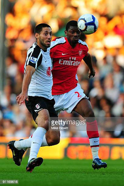 Zoltan Gera of Fulham battles for the ball with Clint Dempsey of Arsenal during the Barclays Premier League match between Fulham and Arsenal at...