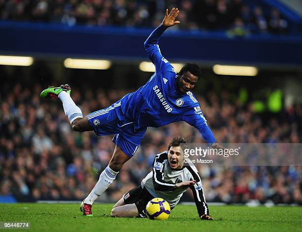 Zoltan Gera of Fulham is challenged by John Obi Mikel of Chelsea during the Barclays Premier League match between Chelsea and Fulham at Stamford...